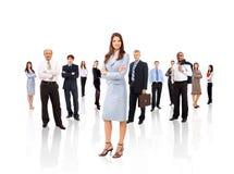 Geschäftsfrau und sein Team getrennt Stockfoto