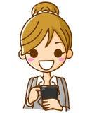 Geschäftsfrau, welche die Telefone bearbeitet Lizenzfreie Stockfotografie