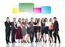 Geschäftsleute, die mit Dialogblasen sprechen Lizenzfreies Stockfoto