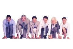 Geschäftsleute, die sich vorbereiten zu laufen Stockfotografie
