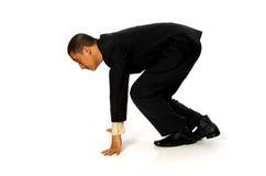 Geschäftsmann betriebsbereit zu laufen Lizenzfreie Stockfotografie