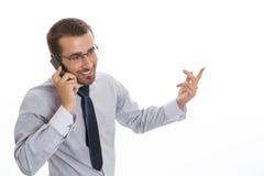 Geschäftsmann, der über Mobiltelefon spricht Stockbild