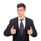 Geschäftsmann, der die Daumen oben getrennt auf Weiß gestikuliert Lizenzfreie Stockfotografie