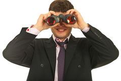 Geschäftsmann, der durch binokulares schaut Stockfotos