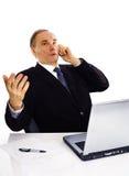 Geschäftsmann, der durch Telefon spricht Stockfotos