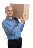 Geschäftsmann, der ein Paketpaket hält Lizenzfreies Stockfoto