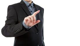 Geschäftsmann, der einen eingebildeten Schirm gegen berührt Lizenzfreie Stockfotos
