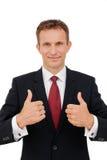 Geschäftsmann, der Ihnen ein Erfolgszeichen auf Weiß zeigt Lizenzfreies Stockfoto