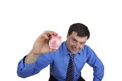Geschäftsmann, der piggy Querneigung anhält Stockfotos