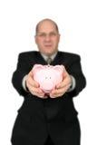 Geschäftsmann, der Piggy Querneigung anhält Lizenzfreies Stockfoto