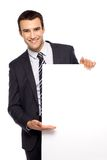 Geschäftsmann, der unbelegtes Plakat anhält Lizenzfreie Stockfotografie