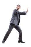Geschäftsmann, der virtuelle Hindernisse wegdrückt Stockbilder