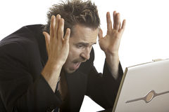 Geschäftsmann hat Druck wegen des Computersystemabsturzes Stockfotos
