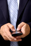 Geschäftsmann am intelligenten Telefon Stockfotografie