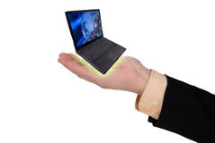 Geschäftsmann mit einer geöffneten Hand und einem Laptop Stockbilder