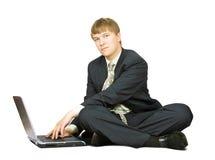 Geschäftsmann mit Laptop Stockfotografie