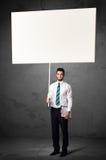 Geschäftsmann mit leerem whiteboard Stockbild