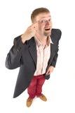 Geschäftsmann mit lustiger Ansicht Stockfotografie
