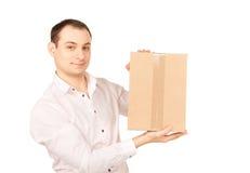 Geschäftsmann mit Paket Stockfotografie
