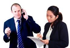 Geschäftsmann mit Sekretär. Lizenzfreies Stockfoto