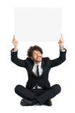 Geschäftsmann-In Suit With-Zeichen Lizenzfreie Stockbilder