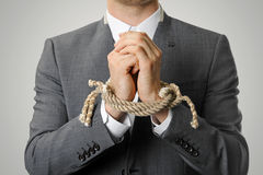 Geschäftsmann With Tied Hands Stockbild