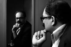Geschäftsmann und seine Reflexion Stockfotos