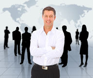 Geschäftsmann und Team Stockfoto