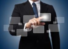 Geschäftsmannberühren Hightech- Stockbilder