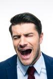 Geschäftsmannschreien lokalisiert auf einem weißen Hintergrund Stockfoto