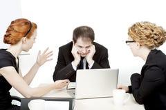 Geschäftsteam in einer ernsten Sitzung Stockfotos