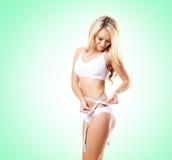 Geschikt en sportief meisje in wit ondergoed Mooie en gezonde wo stock foto