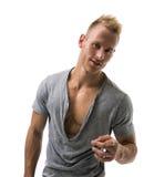 Geschikt mannelijk model die en vinger glimlachen richten aan camera Stock Afbeelding