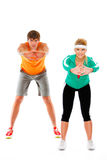 Geschikte vrouw en man die sportoefening maken Stock Afbeeldingen