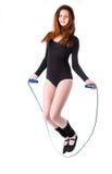 Geschiktheidsvrouw met touwtjespringen Stock Afbeelding