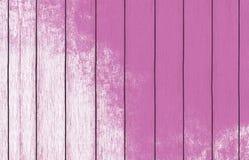 Geschilderd houten behang als achtergrond met roze verf stock foto