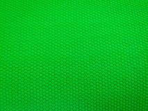 Geschilderd rubber als achtergrond, ruwe oppervlakte, groene achtergrond stock foto's