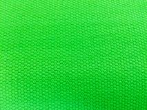 Geschilderd rubber als achtergrond, ruwe oppervlakte, groene achtergrond royalty-vrije stock foto's