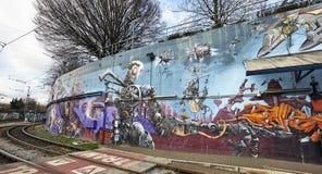 Geschilderde graffiti op een de bouwmuur in Brussel, België Royalty-vrije Stock Fotografie