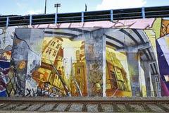 Geschilderde graffiti op een de bouwmuur in Brussel, België Royalty-vrije Stock Foto