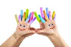 Geschilderde handen met glimlach Stock Foto's