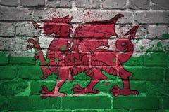Geschilderde nationale vlag van Wales op een bakstenen muur stock foto's