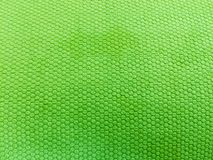 Geschilderde rubber, ruwe oppervlakte, groene achtergrond stock afbeeldingen