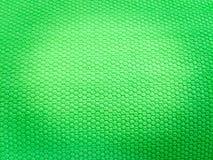 Geschilderde rubber, ruwe oppervlakte, groene achtergrond stock fotografie