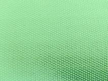 Geschilderde rubber, ruwe oppervlakte, groene achtergrond royalty-vrije stock foto