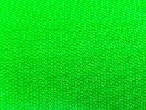 Geschilderde rubber, ruwe oppervlakte, groene achtergrond stock foto's