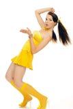 Geschlechtsmädchen in einem gelben Kleid Lizenzfreies Stockfoto