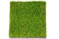 Geschlossen herauf grünen künstlichen Grasplattenhintergrund Lizenzfreie Stockfotografie