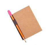 Geschlossene Auflage mit Bleistift im Halter Stockbild