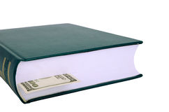 Geschlossenes Buch mit einem Bookmark $ 100 auf dem links Stockfotos